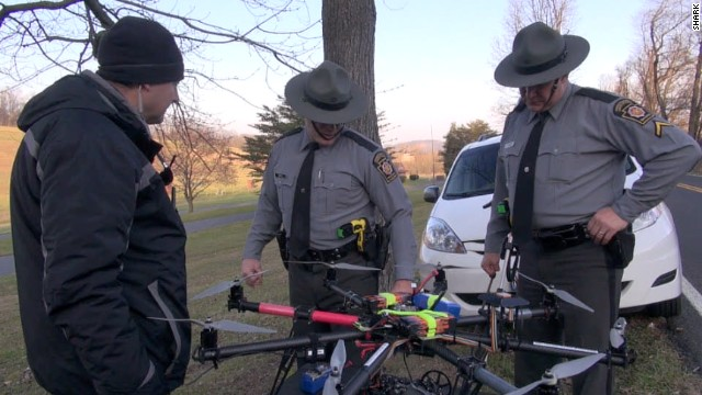 Officers inspect a drone launched by animal rights group SHARK after it was shot down in PA (CNN)