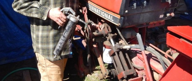 Greasing Tractors by Farmer Kristin
